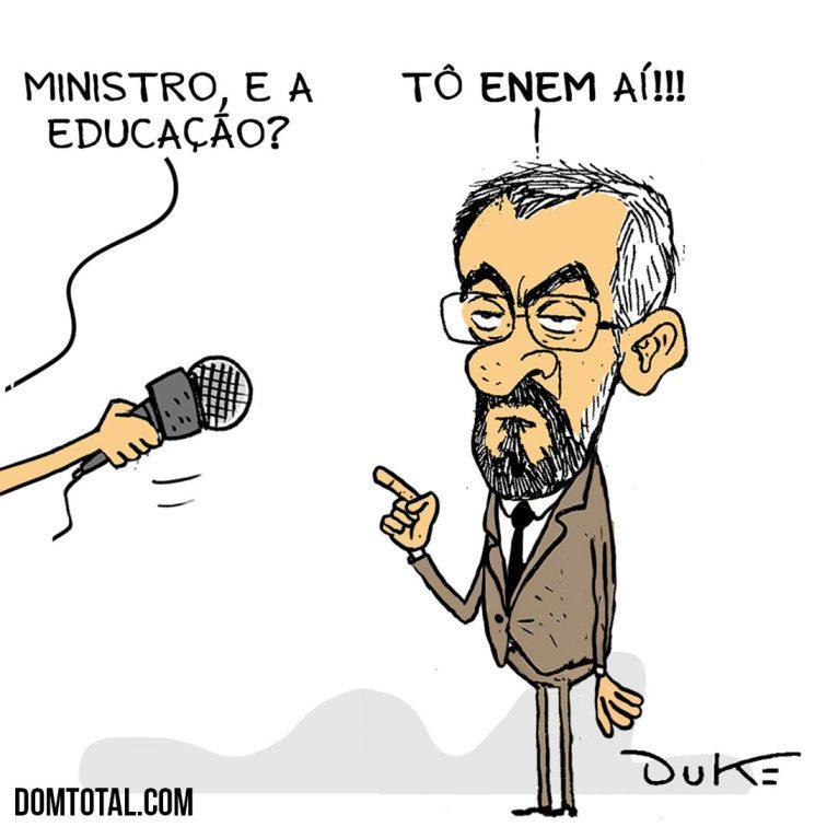 """Charge mostrando uma mão com um microfone e o ministro da educação Weintraub fazendo a seguinte. Uma fala surge da direção que aparece a mão, dizendo """"Ministro, e a educação?"""" e o ministro responde """"Tô enem aí!!!"""""""